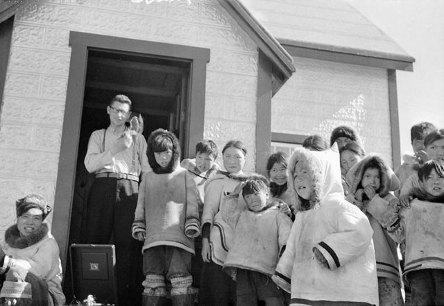 Photo Father Trinell with group of Inuit children